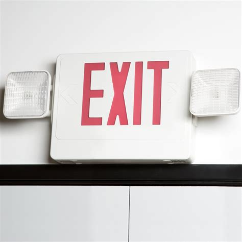 Exit A exit sign and emergency light combination with battery