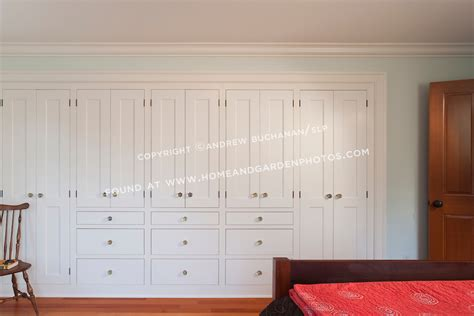 Bedroom wall storage cabinets solid wall of built in storage cabinets
