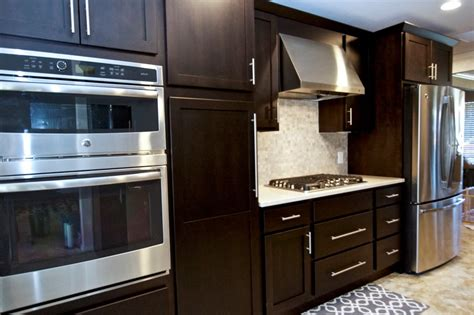 bifold cabinet doors with ceiling lighting recessed glass