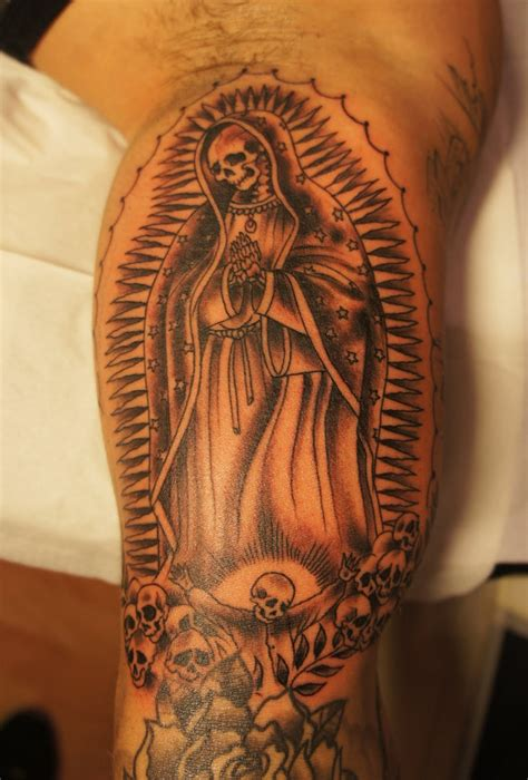 skull virgin mary arm tattoo design for men religious