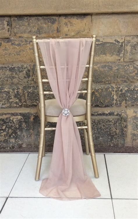 our blush pink chiffon chair wraps look so romantic for an