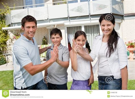 buying house from family excited family celebrating buying new house stock photo