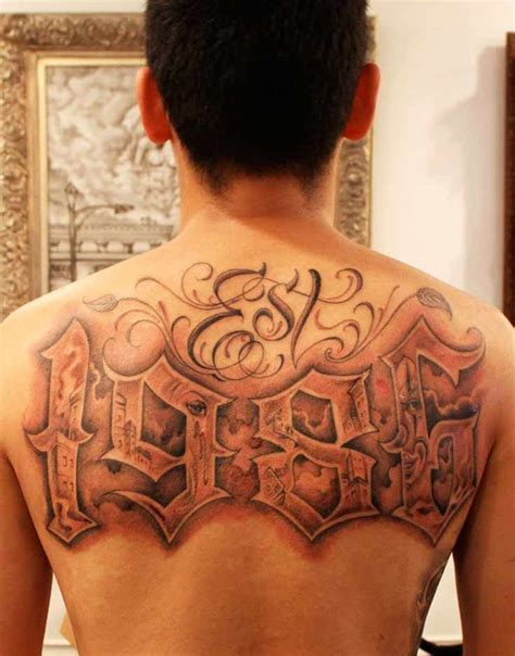 tattoo your back like a jersey a back lettering tattoo like no other the numbers are