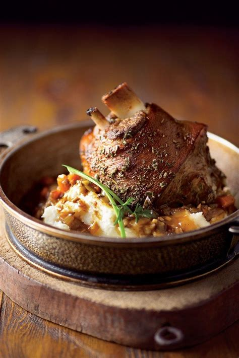braised and roasted pork shanks with prosciutto and
