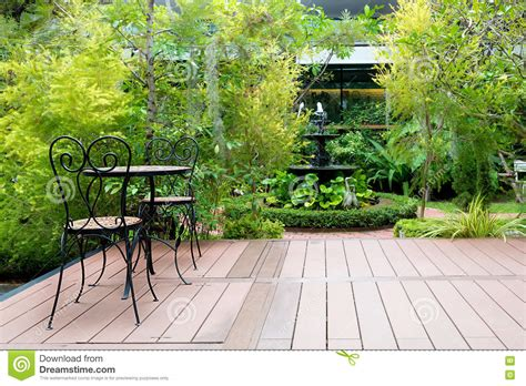 Green Patio Chair by Wood Chair In Garden Royalty Free Stock Image