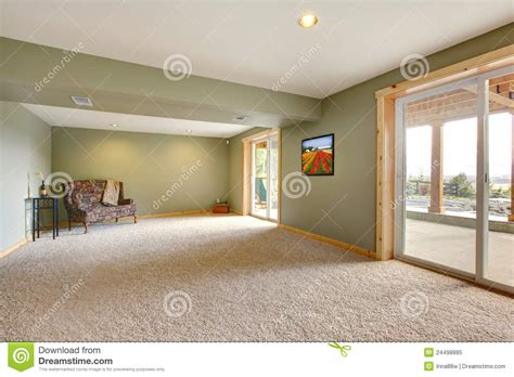 Level Furnished Living ground level large new living room with green walls