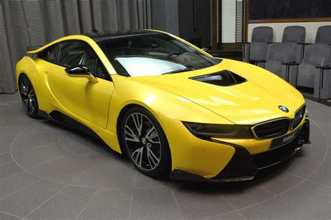 bmw in the bmw i8 in lava yellow