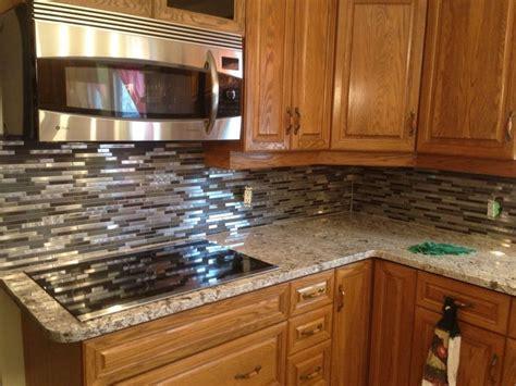 giallo fiorito granite with oak cabinets giallo ornamental granite with a mosaic backsplash
