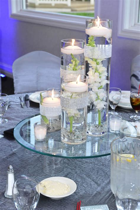 wedding centrepieces with floating candles floating candle wedding centerpieces with cylinder