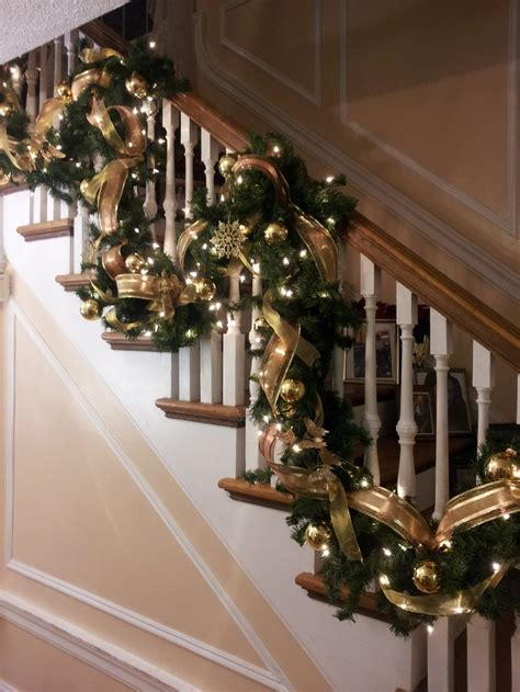 christmas decorations banister christmas garland banister maybe do the red plaid bows as