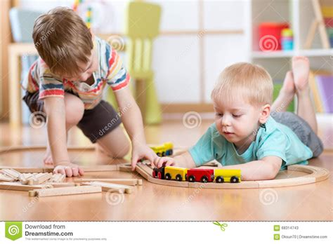 children with wooden toddler play