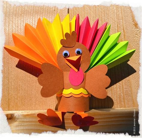 Thanksgiving Toilet Paper Roll Crafts - folded colored paper roll of toilet paper cut in half