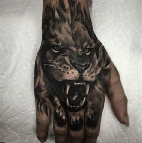 animal tattoo on hand tattoo roaring lion on hand http tattootodesign com