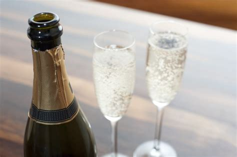 Two flutes of sparkling champagne   Free Stock Image