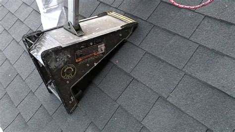 ladder on a roof pivit ladder tool on a steep roof tips using a ladder on