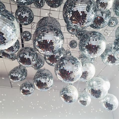ceiling covered in disco balls fun unique wedding