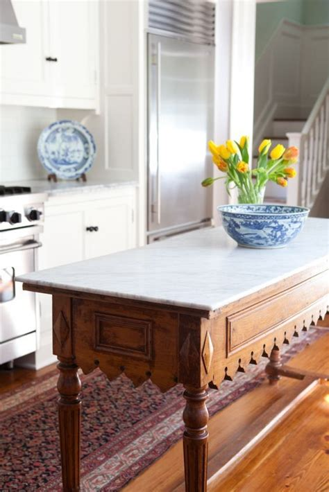 marble kitchen island table the 25 best traditional decor ideas on pinterest
