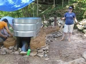 The New Small House cob hot tub heathcote community