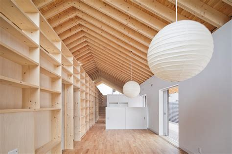 Garage Truss Design house with exposed timber rafters and bookshelf columns