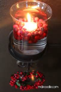 floating candles and fresh cranberries decor