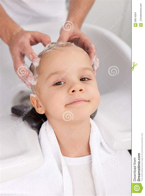pretty verry young boys washing hairs verry young boys washing hairs professional young barber