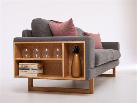 divano libreria divano in tessuto a 2 posti con portariviste libreria by