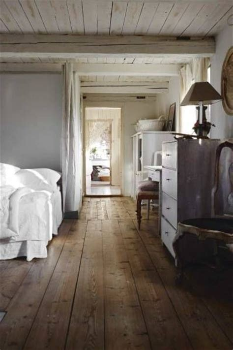 love the rustic style the wooden floors white painted wood on the ceiling and the furniture
