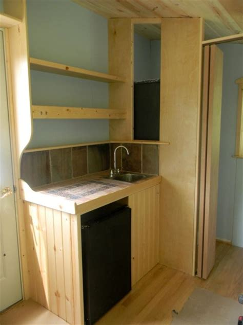 112 square feet off grid tiny house with folding porch roof 112 square feet off grid tiny house with folding porch roof