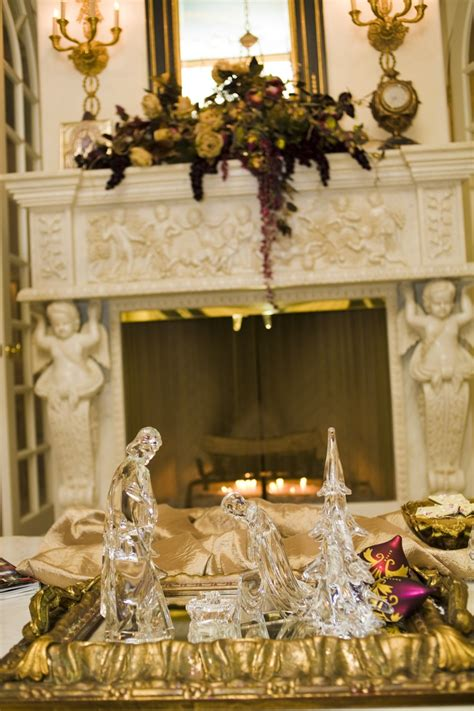 fireplace mantle   gold room reflecting christmas