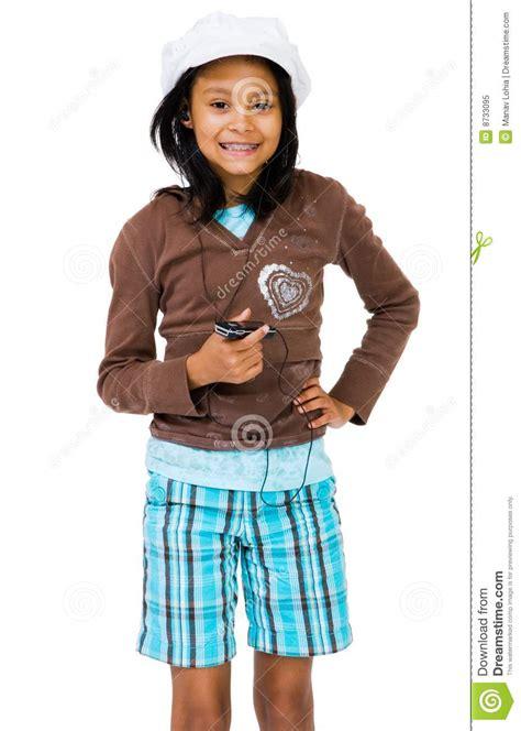 latin american girl listening mp royalty  stock photo