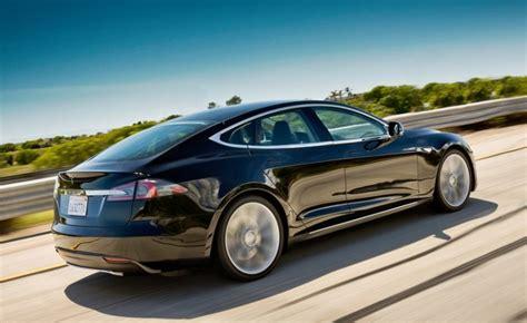 Tesla Four Door Tesla Posts 38 Million Loss Stock Drops 10 Percent