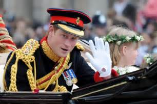 Prince harry best man prince harry waves to the crowd as he makes the