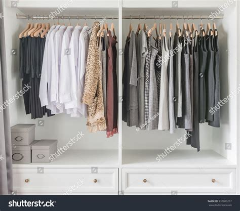 Wardrobe Clothes Hanging Rail by White Wardrobe With Clothes Hanging On Rail Stock Photo