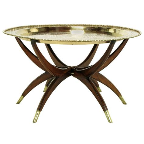 Six Tables by Moroccan Incised Brass And Mahogany Folding Six Leg Tray