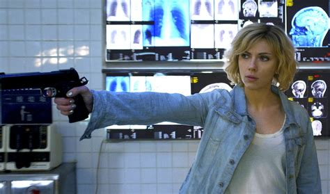 lucy film questions review scarlett johansson kicks ass in luc besson s