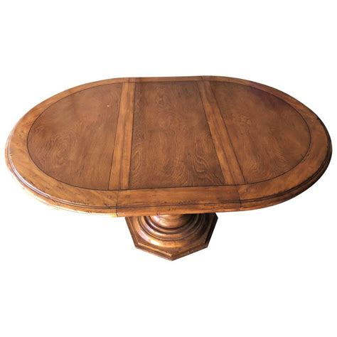 large wooden baroque style pedestal dining room table