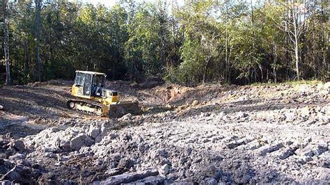 digging a backyard pond bulldozer digging pond youtube