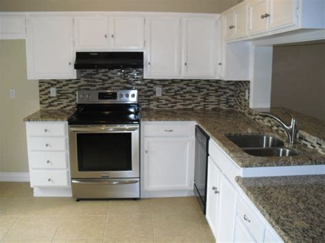 How To Install A Tile Backsplash In Kitchen white cabinets what color granite countertop and