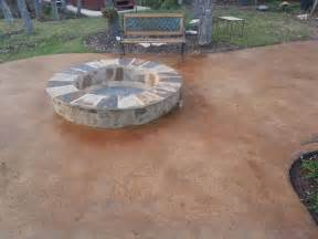 stained concrete patio with built in fire pit north by northwest lawns north by northwest lawns