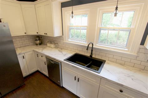 White Kitchen With Marble Look Laminate Countertop Akron White Formica Kitchen Cabinets
