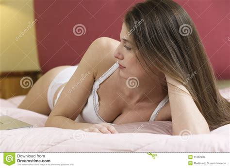 girl in bed young woman lying in bed stock photo image 11062930