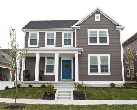 tan house colors blue door white trim smokey gray brown siding a pop