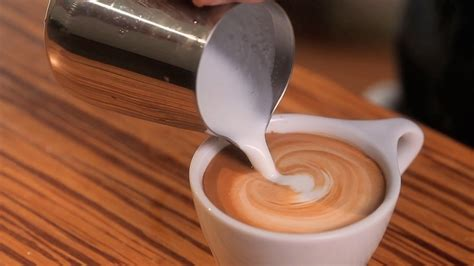 how to make designs on coffee how to free pour latte art youtube