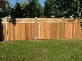 This backyard privacy fence has short wide lattice panels