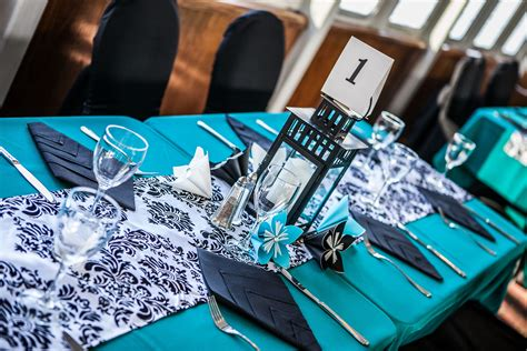 black white and turquoise fairytale wedding cruise wedding decor tablescapes black