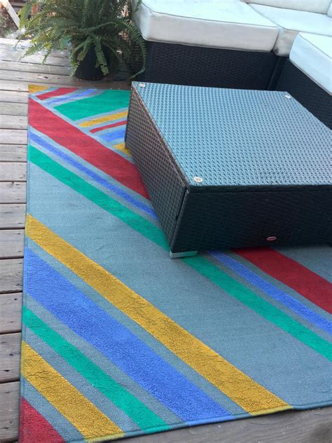 Make An Outdoor Rug by 3 Ways To Dress Up A Basic Outdoor Rug Hgtv