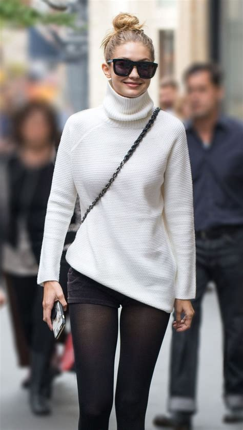 Slingbag Trico gigi hadid wearing a burch turtleneck looking great
