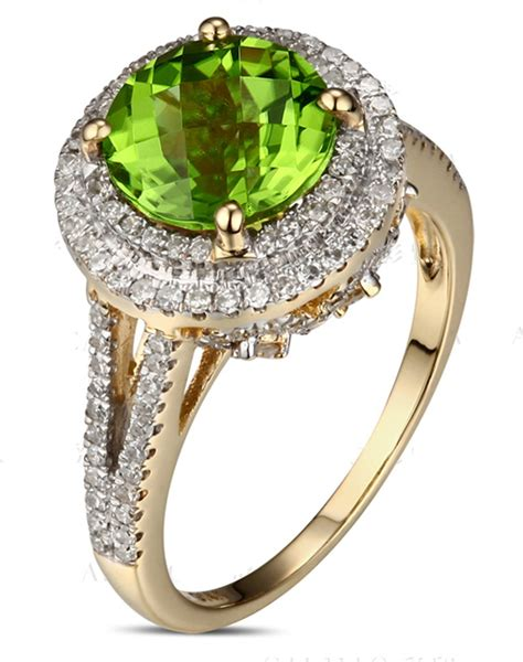 2 carat emerald and halo engagement ring in yellow