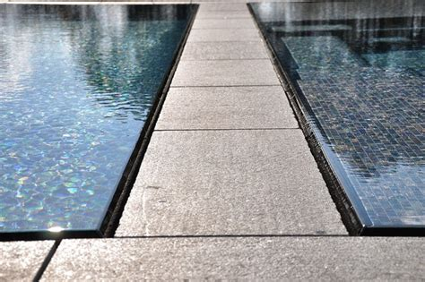modern glass tile swimming pool spa with perimeter