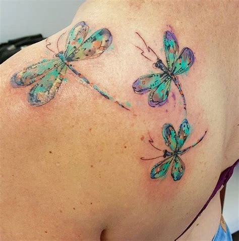 colorful dragonfly tattoos on left back shoulder